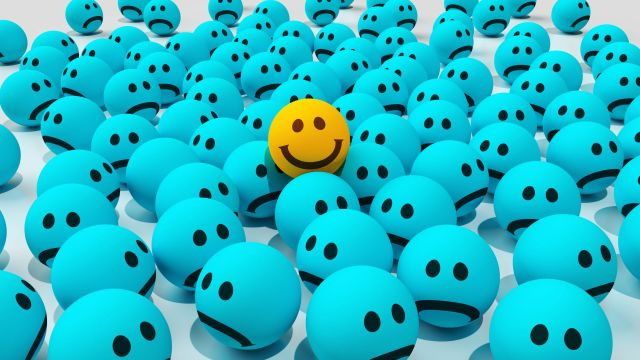 Yellow Cheerful Smile in Pile Blue Sad Emoticons