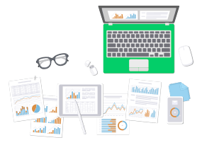 Image of laptop with sheets of papers with charts and graphs surrounding it