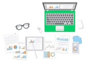 Image of a laptop and in front lie many different sheets with various types of graphs to illustrate SEO Audit and Optimization
