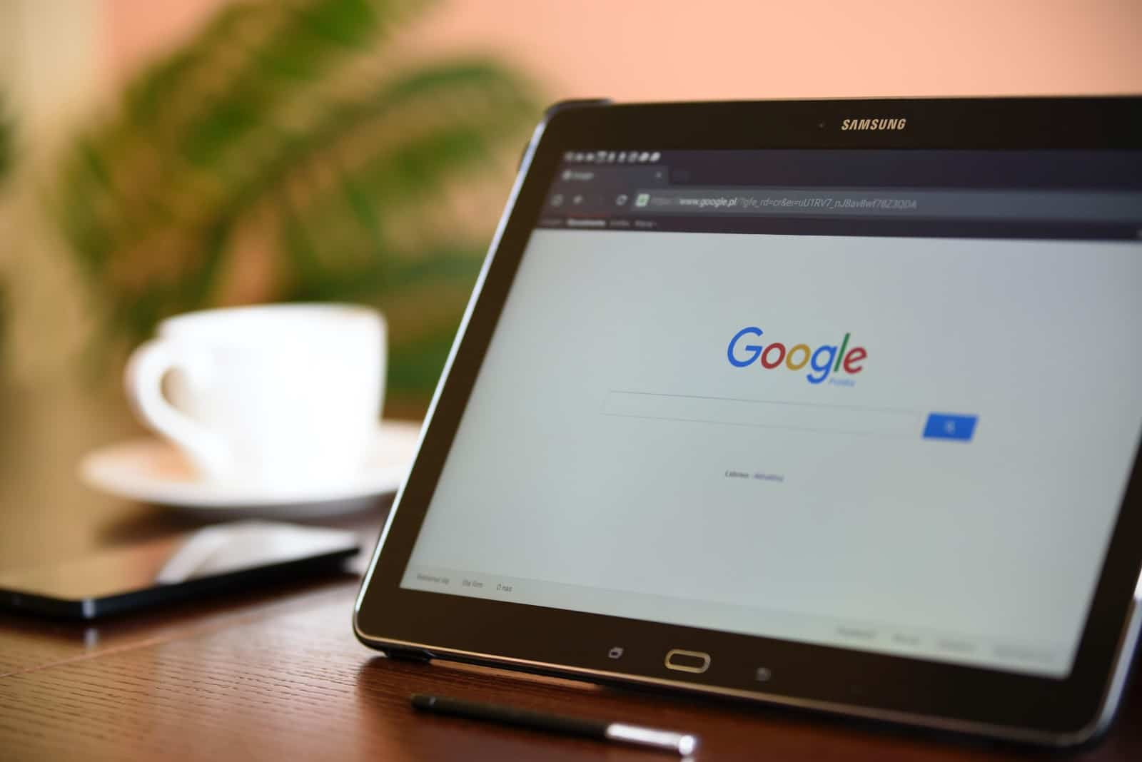 picture of google pulled up on ipad beside coffee mug